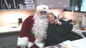 Here's Mom and that Santa guy. That doesn't look like work to us!